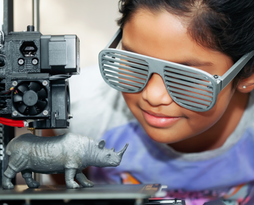 Child learning to use a 3D printer at iCode